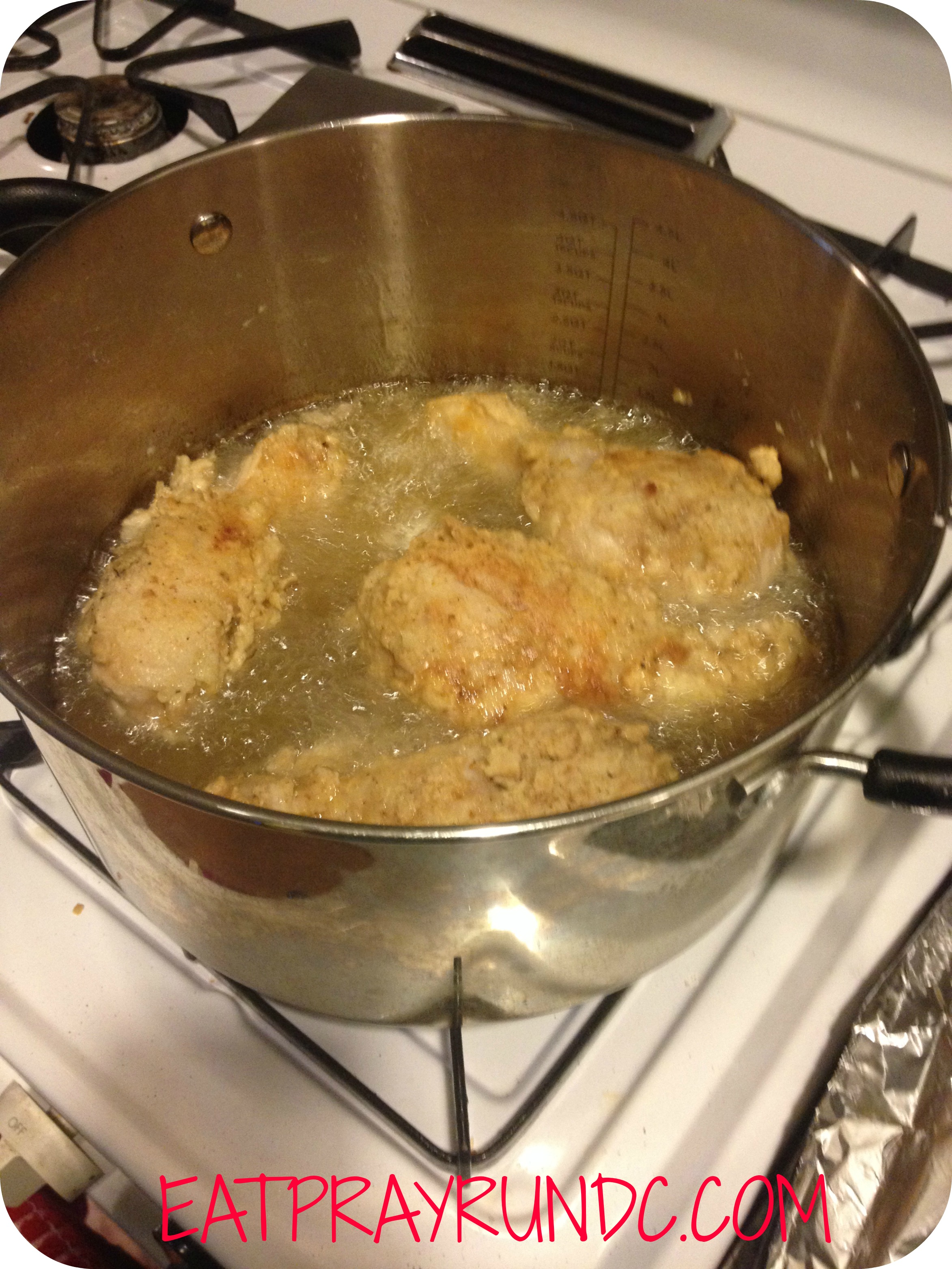 chicken frying in pot